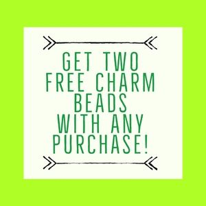 Two FREE Charms with any Purchase!